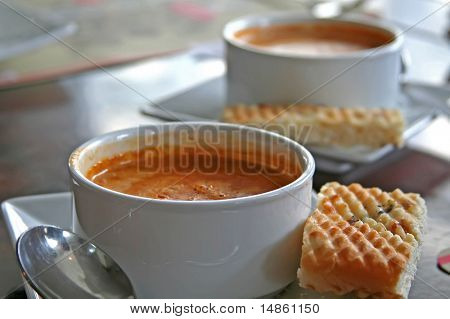 Bowl of lobster bisque in white bowl casual restaurant setting