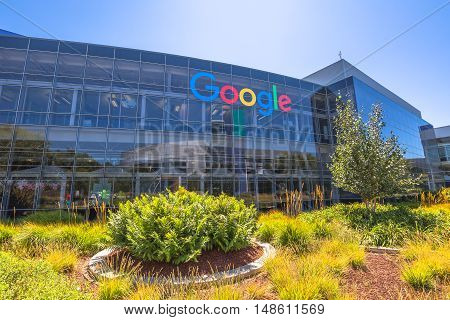 Mountain View, California, USA - August 15, 2016: Google sign on one of the Google buildings. Exterior view of a Google headquarters building. Google is specializing in Internet services