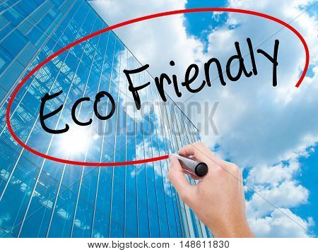 Man Hand Writing Eco Friendly With Black Marker On Visual Screen