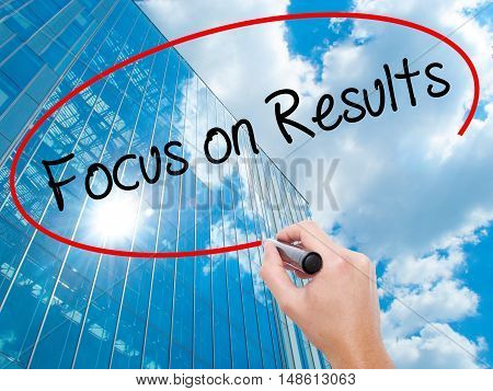 Man Hand Writing Focus On Results With Black Marker On Visual Screen