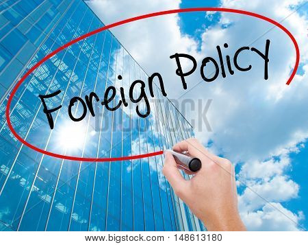Man Hand Writing Foreign Policy With Black Marker On Visual Screen