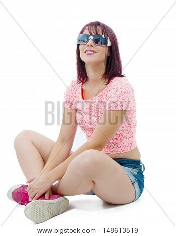 a pretty young woman sitting cross-legged on white background