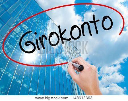 Man Hand Writing  Girokonto (checking Account) With Black Marker On Visual Screen