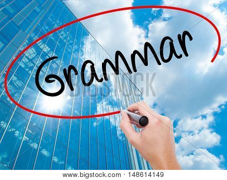 Man Hand Writing Grammar With Black Marker On Visual Screen
