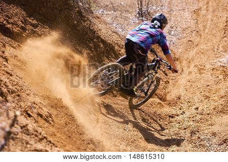 Mountainbiker rides in gorge on desert place