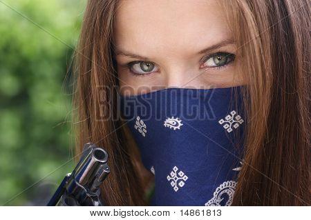 Girl in Bandanna with gun