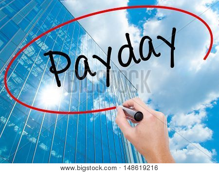 Man Hand Writing Payday With Black Marker On Visual Screen