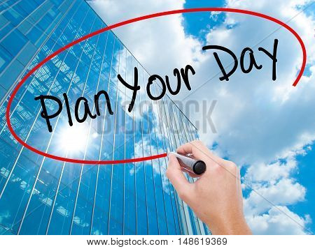 Man Hand Writing Plan Your Day With Black Marker On Visual Screen