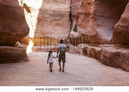 PETRA JORDAN - OCTOBER 29 2014: Unidentified tourists in the Siq - natural narrow passageway to Petra
