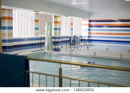 small indoor swimming pool empty, noone sport real life concept