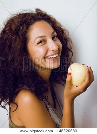 pretty young real tenage girl eating apple close up smiling, woman eating health food