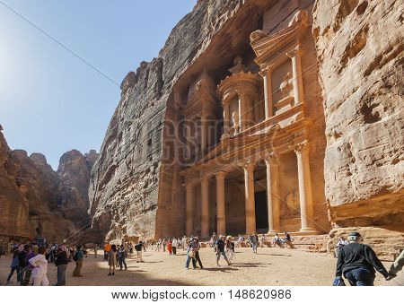 PETRA JORDAN - OCTOBER 29 2014: The treasury - Petra's most elaborate ruin is also called Al Khazna hewn into the sandstone cliff.