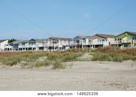 Luxury beach houses along the sand dunes; Sunset Beach, North Carolina