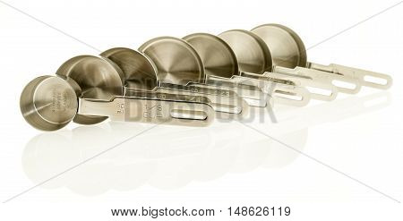 Stainless steel measuring cups on an isolated background