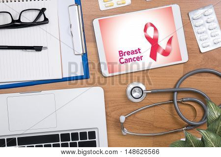 Breast Disease Breast Cancer Professional doctor use computer and medical equipment all around desktop top view poster