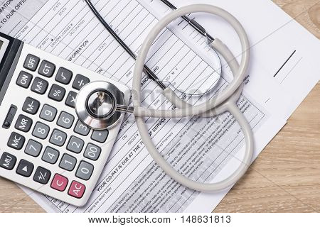 Health care costs. Stethoscope and calculator symbol for health care costs or medical insurance