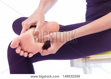 Woman with feet pain on white background