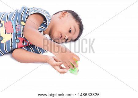 cute child little boy lying play car toy