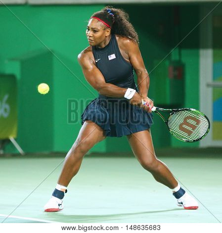 RIO DE JANEIRO, BRAZIL - AUGUST 9, 2016: Olympic champions Serena Williams of United States in action during singles round three match of the Rio 2016 Olympic Games at the Olympic Tennis Centre