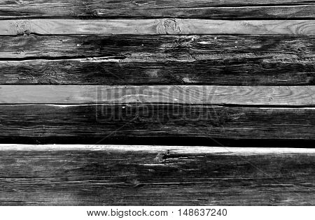 Old Black And White  Log House With Orange Planks