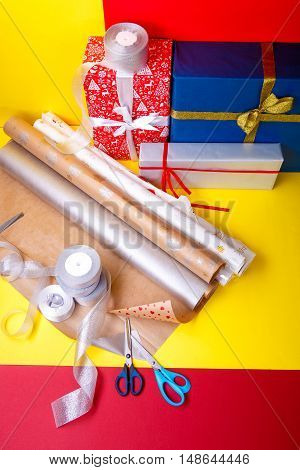 Gift Wrapping, Boxes, Paper, Ribbon And Scissors On Color Background. Materials  Accessories For  Pr