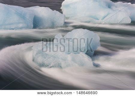 Ice blocks in flowing river Jokulsa at Jokulsarlon glacier lagoon in the Vatnajokull National Park Iceland