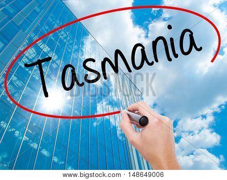 Man Hand Writing Tasmania With Black Marker On Visual Screen