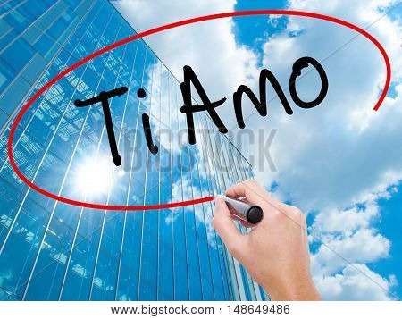 Man Hand Writing Ti Amo (i Love You In Italian) With Black Marker On Visual Screen.