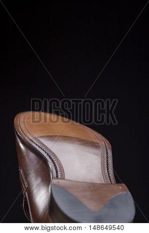 Downward Side of Penny Loafer Natural Leather Sole. Closeup Shot. Vertical Image Composition