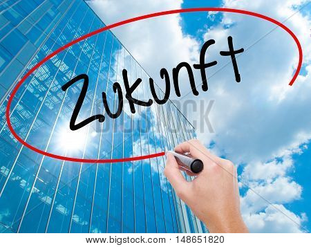 Man Hand Writing Zukunft (future In German)  With Black Marker On Visual Screen