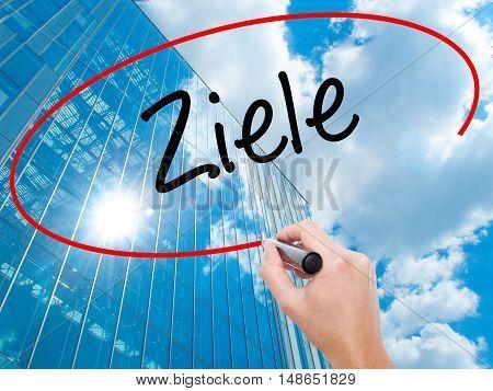 Man Hand Writing Ziele  (goalsin German) With Black Marker On Visual Screen