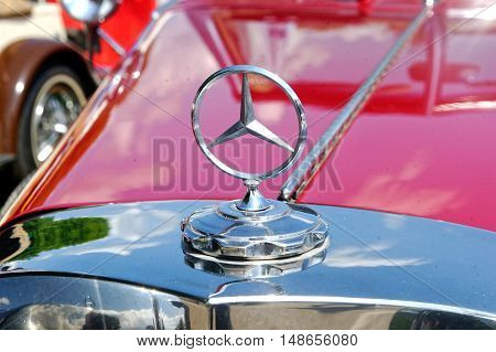 Kharkiv Ukraine - May 22 2016: Close up of the hood ornament of retro car red Mercedes-Benz Cabriolet manufactured in 1934 is presented at the festival of vintage cars Kharkiv Retro Rally - 2016 in Kharkiv Ukraine on May 22 2016
