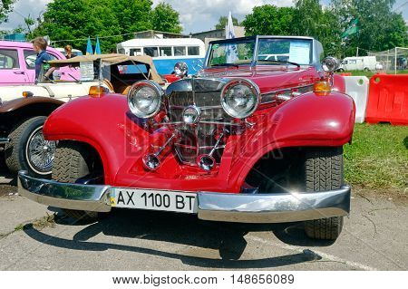 Kharkiv Ukraine - May 22 2016: Retro car red Mercedes-Benz Cabriolet manufactured in 1934 is presented at the festival of vintage cars Kharkiv Retro Rally - 2016 in Kharkiv Ukraine on May 22 2016