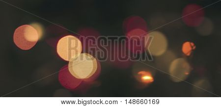 Abstract blurred defocused city night lights in orange and red colors bokeh