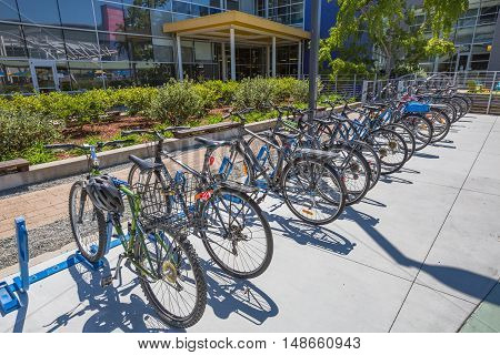 Mountain View, California, United States - August 15, 2016: the colorated bikes used by Google employees to move around the Google headquarters, also called Googleplex. Google bicycle in its campus.