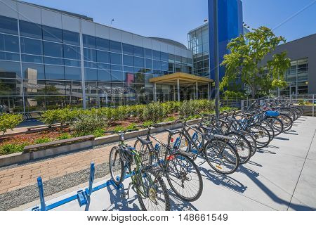 Mountain View, California, United States - August 15, 2016: the bikes used by Google employees to move around the Google headquarters area, also called Googleplex. Google bicycle in its campus.