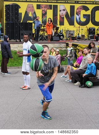 St. Petersburg, Russia - 13 August, An athlete with two spinning balls,13 August, 2016. Performance of the ball virtuosos on Krestovsky Island in St. Petersburg.