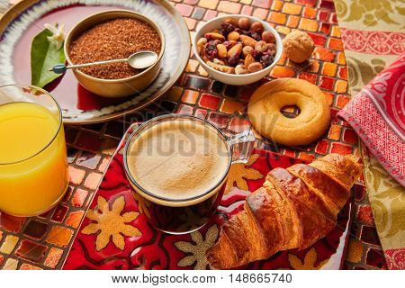 Breakfast continental with croissant coffe and orange juice