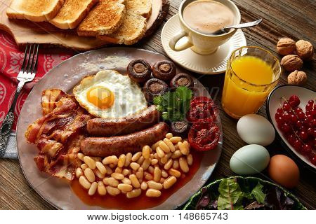 English breakfast with sausages egg beans bacon mushrooms and grilled tomato