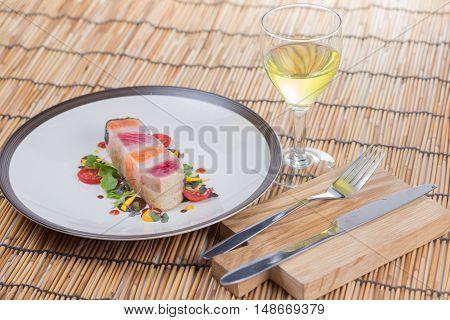 Steak layer fish and white wine / SalmonTuna and seabass gfish Steak