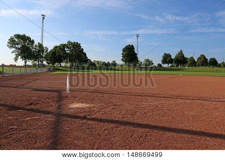 An empty softball field on a sunny day.