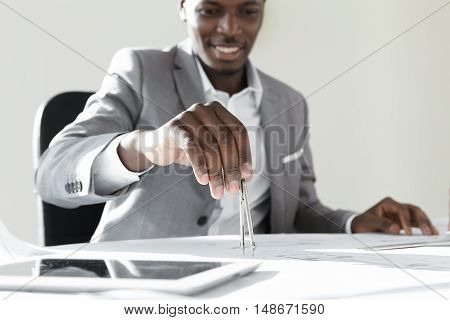 Attractive Dark-skinned Architect Or Engineer Holding Technical Drawing Instrument, Designing New Bu