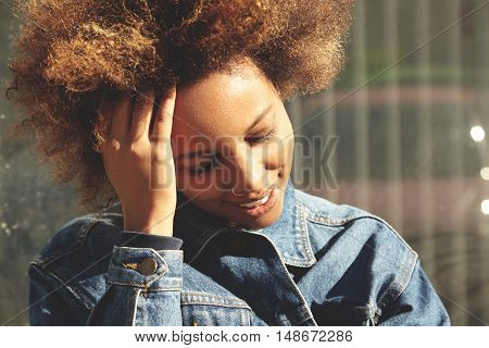 Flare Sun. Portrait Of Attractive African Woman With Nose-ring And Cute Smile, Closing Her Eyes Beca