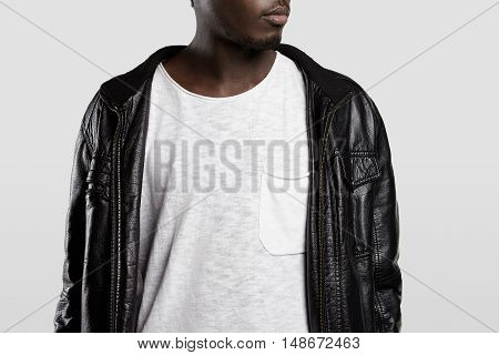 Cropped Portrait Of Attractive African American Man In Trendy Leather Jacket And White T-shirt With