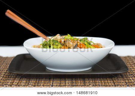 Stirfried pork, and vegetables  Ramen noodle bowl