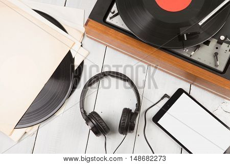 Vintage Turntable, Smartphone And Headphones