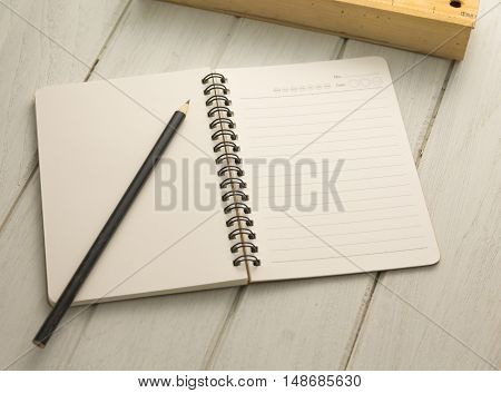 Open a blank white notebook on the desk