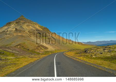 Isolated Road And Icelandic Colorful Landscape At Iceland, Summer Time