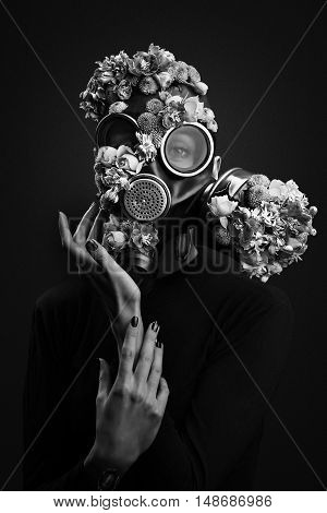 Portrait Of Woman With Flowers Growing Through Respirator Mask. Black And White. Add Noise Effect.
