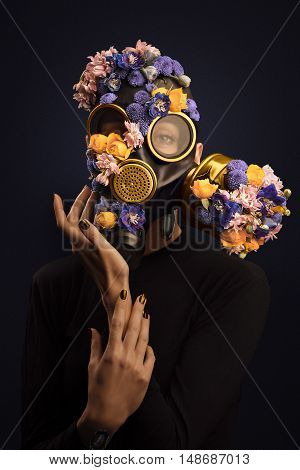 Portrait Of Woman With Flowers Growing Through Respirator Mask. Add Noise Effect